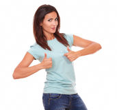 Charming adult brunette with ok sign Royalty Free Stock Photography