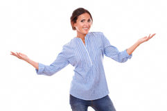 Charming adult female holding up her arms Royalty Free Stock Image