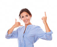 Charming adult lady with call gesture pointing up Royalty Free Stock Images