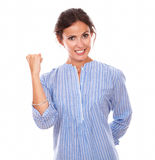 Charming adult lady punching up on victory gesture Stock Image