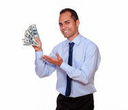 Charming adult man showing you cash money Royalty Free Stock Photography