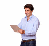 Charming adult man working on tablet pc Stock Image