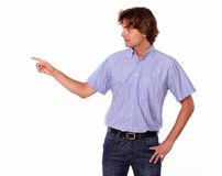 Charming adult standing pointing to the right.. Stock Photos