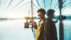 Black girl with cellphone outdoors stock photo