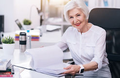 Charming aged business lady working in the office stock image