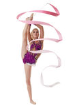 Charming artistic gymnast dancing with pink ribbon Stock Photo