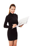 Charming  Asian Businesswoman Holding A Folder Smiling At Camera Against. Stock Photo