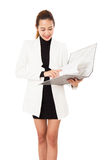 Charming Asian Businesswoman Holding A Folder Smiling At Camera Against. Royalty Free Stock Images