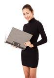 Charming  Asian Businesswoman Holding A Folder. Stock Photo