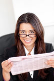 Charming asian businesswoman holding a newspaper Royalty Free Stock Image