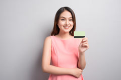 Charming asian woman hand show credit card. Presenting your prod Royalty Free Stock Image