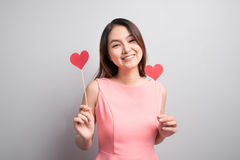 Charming asian woman holding red heart shape. Stock Photos