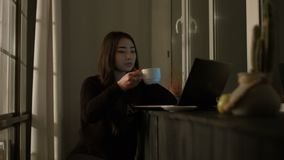 Charming asian woman working with laptop at night stock video