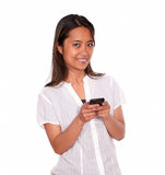 Charming asiatic young woman calling on cellphone Stock Photography