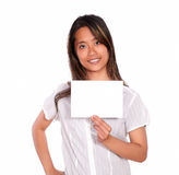 Charming asiatic young woman holding a white card Royalty Free Stock Photos