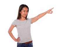 Charming asiatic young woman pointing to left up Royalty Free Stock Photo