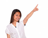 Charming asiatic young woman pointing to left up Royalty Free Stock Photos