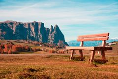 Charming autumn landscape with a gigantic bench record in Alpe d. I Siusi, Italy, Dolomiti Royalty Free Stock Photography
