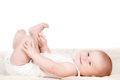Charming babe is sitting on the bed. Stock Photo