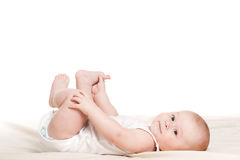 Charming babe is sitting on the bed. Royalty Free Stock Photography