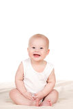 Charming babe is sitting on the bed. Royalty Free Stock Photos