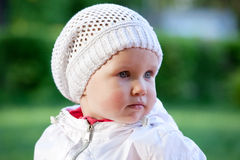 Charming babe in a white jacket Royalty Free Stock Image