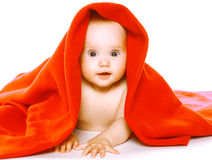 Charming baby crawls in towel Stock Photo