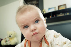 Charming baby with funny face expression Royalty Free Stock Image