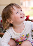 Charming baby toddler girl having fun. Stock Photo