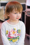 Charming baby toddler girl having fun. Stock Photos