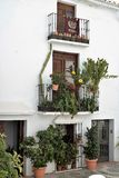 Charming balconies decorated with plants and pots in Frigiliana, Spanish white village Andalusia. Beautiful and charming with its narrow streets and footpaths Stock Photos