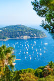 Charming Bay on the Cote d'Azur in Villefranche-sur-Mer, France. Charming Blue Bay with a lot of yachts and boats anchored on the Cote d'Azur in Villefranche royalty free stock photo