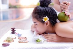 Charming beautiful asian woman love to get massage and aromatherapy that makes attractive beautiful girl feels relaxed and happy. royalty free stock images