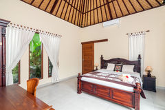 Charming and Beautiful Bedroom Tropical Villa Stock Photo