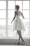 Charming beautiful bride. Standing on the window Stock Photos