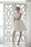 Charming beautiful bride. Standing on the window Stock Photography