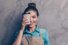 Charming, beautiful girl holding drink in front of her close hal stock image