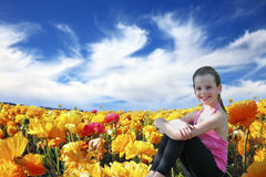 Charming beautiful six year old girl  smiling in a field Royalty Free Stock Image