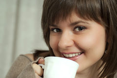 Charming beautiful woman holds a cup Stock Image