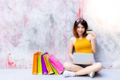 Charming beautiful woman is showing credit card. Attractive beau stock photo