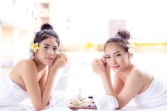 Charming beautiful women are looking customer. Attractive girls royalty free stock photography