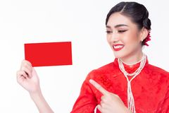 Charming beautiful young woman looking and pointing finger to red envelope. Attractive beautiful girl get happiness when gorgeous royalty free stock photo