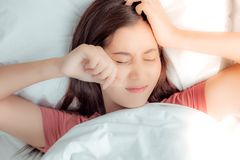 Charming beautiful young woman is waking up late and the sun is royalty free stock photography