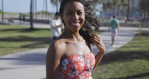 Charming black girl in dress laughing at camera stock footage