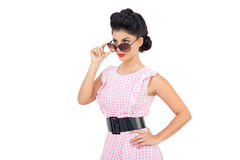 Charming black hair model looking over her sunglasses Stock Photo