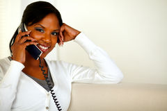 Charming black woman looking and smiling at you Royalty Free Stock Photography