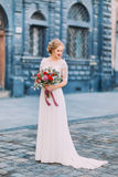 Charming blond bride with vintage bouquet in Lviv city center Royalty Free Stock Photography