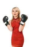 Charming blond girl in boxing gloves Royalty Free Stock Photos