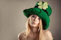 Charming blond girl in image of leprechaun with air kiss gesture Stock Photography