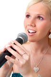 Charming blond girl with microphone. Isolated on whtite background royalty free stock photography